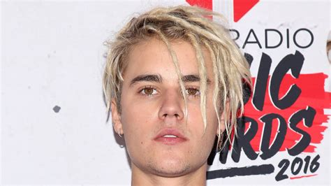 justin bieber ditches dreadlocks sports freshly shaved