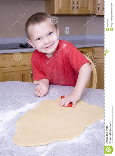 boy cut out stock photos pictures royalty free boy cut boy cutting out cookie royalty free stock photo image