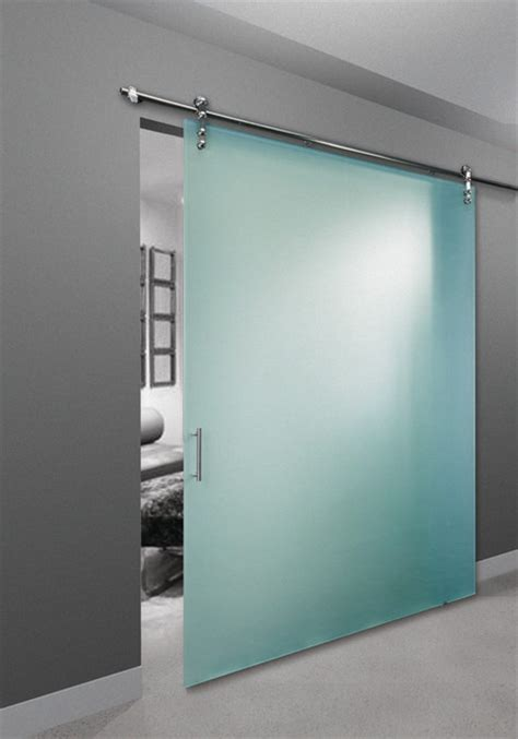 frameless glass barn door bedroom