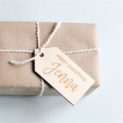 personalised wooden christmas gift tags by fira studio