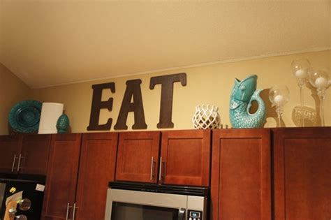 decor over kitchen cabinets decorating above the kitchen cabinets little lessons in