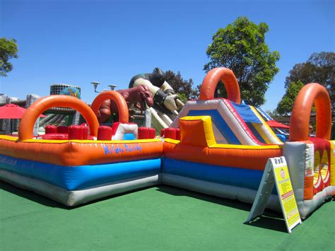 blow up bounce house inflatable world lets kids jump slide and climb huge inflatables family vacation hub