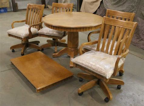 kitchen table with leaf and 4 rolling chairs