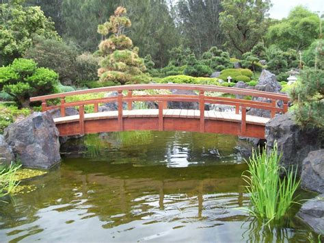 koi pond bridge bridge over the koi pond by melthepirate on deviantart