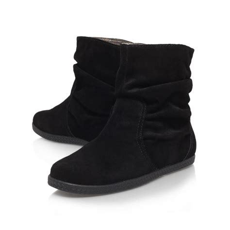black ankle flat shoes nine west rockinout flat ankle boots in black lyst