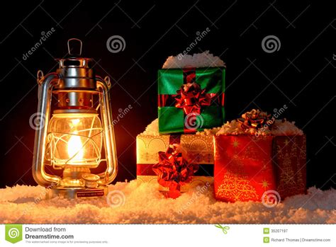 christmas gifts and oil l on snow stock image image