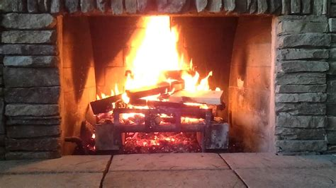 crackling fireplace glowing embers poping 1