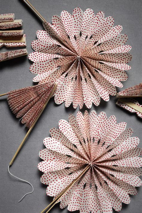 how to make paper fans on a stick paper fans i think i could make this fold paper cut