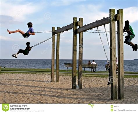 swing on kids on a swing stock image image of child children