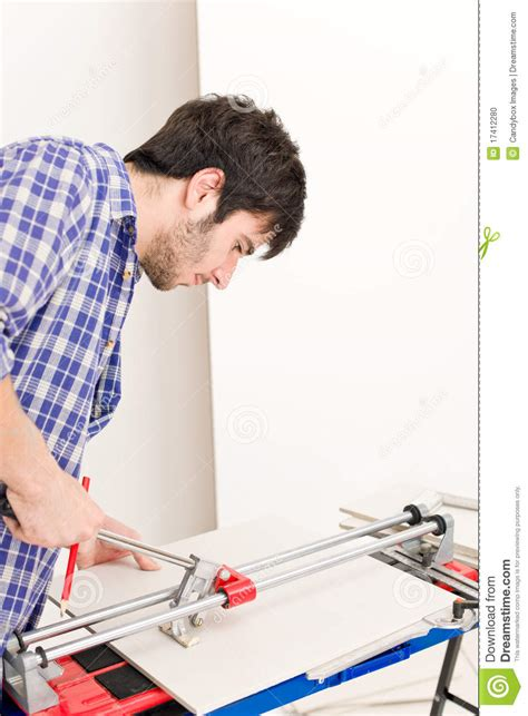 home improvement handyman cut tile stock photo image