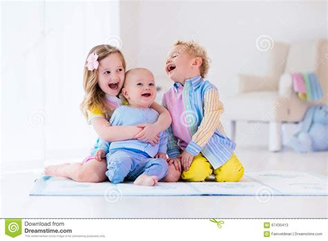 play in the bedroom kids playing in white bedroom stock photo image 67430413