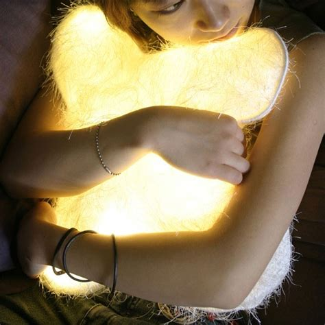 light up hug pillow d light pillow is probably made of unicorn and care bear