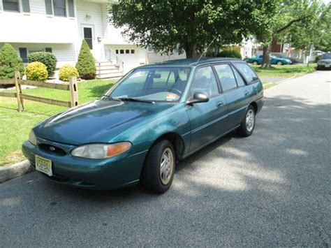 green ford station wagon buy used green ford lx station wagon 1997 98 000