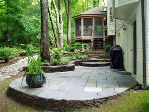 traditional flagstone patio with raised flower beds hgtv