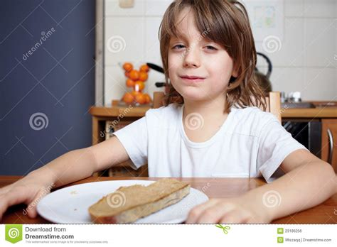 doesn t want to eat boy sits at kitchen table and doesn t want to eat royalty free stock image image