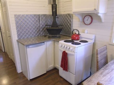 Debra's Tiny House for Sale: 10x38 Cottage on Wheels