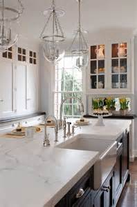 this classic kitchen features white cabinetry around the