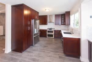 Kitchens With Cherry Cabinets And Wood Floors Gray Wood Floors Warm Cherry Cabinets White Counters Contemporary Kitchen Kitchens