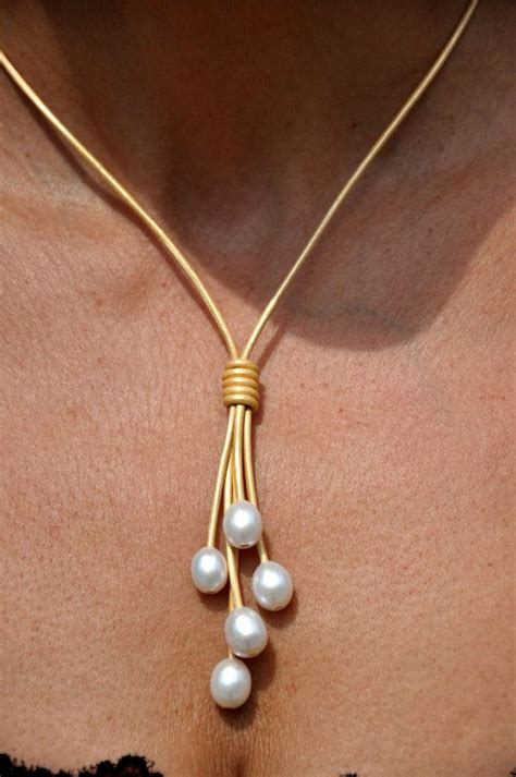 leather and pearl jewelry freshwater pearl and leather necklace 5 pearl metalic gold lariat