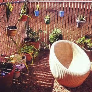 using zip ties to decorate chain link fence with plants a