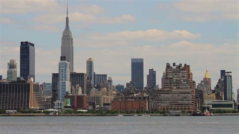 speed boat on hudson river empire state building new york city s world famous empire