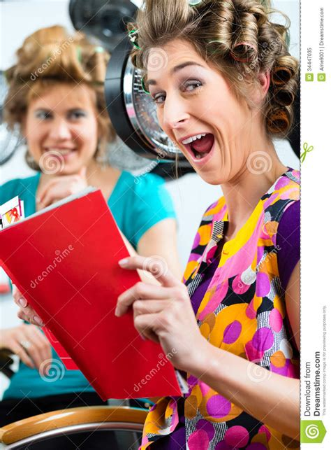 Hair Dresser Reading by At The Hairdresser With Hair Dryer Royalty Free Stock Photo Image 34447035