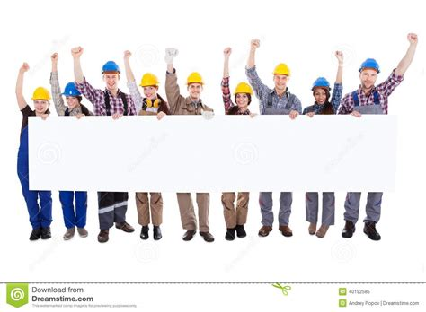 work pictures of workmen holding a blank white banner stock image