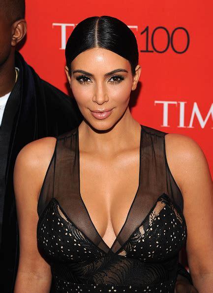 kim kardashians low sleek ponytail with center part celebrity mane addicts how to kim kardashian sleek by michael silva