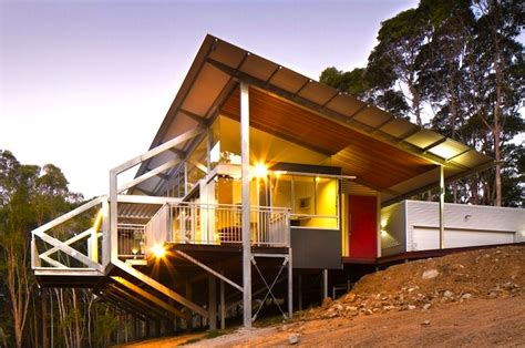 eco friendly tinbeerwah house rises on steel stilts in the