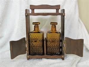 vintage wooden table top liquor cabinet with decanter bottles