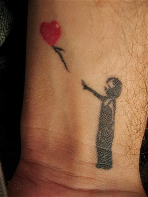 tattoo love boy boy and heart balloon wrist tattoo