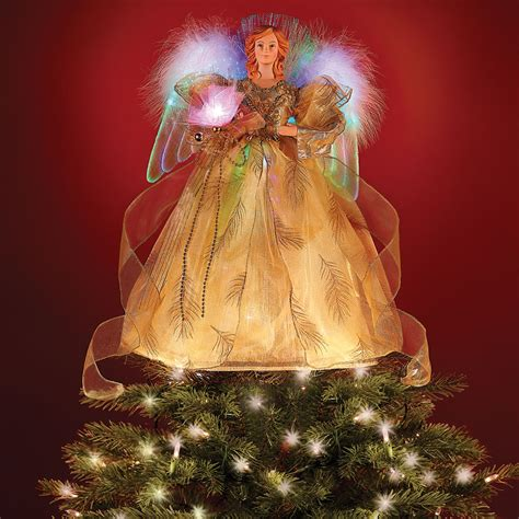 motorized angel tree topper wings head and arms move the fiber optic tree topper hammacher schlemmer