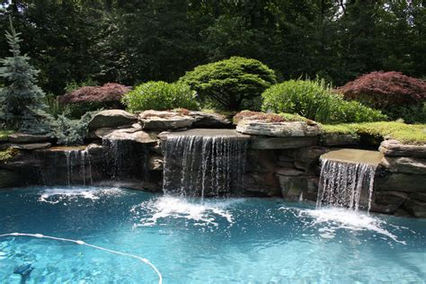 pool waterfalls modern pool landscaping ideas with rocks and plants
