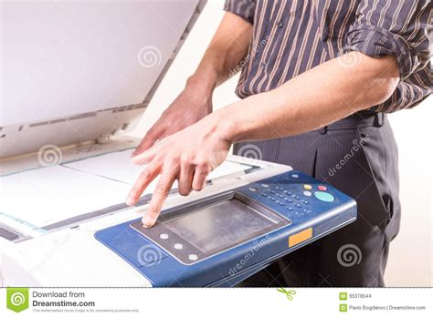 Where To Make Copies Of Papers - using copier to make copies of documents stock photo