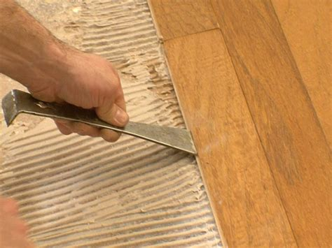how to install engineered wood over concrete howtos diy plywood subfloor over concrete in