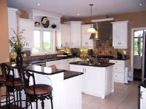 Kitchen with white cabinets stainless steel appliances and black