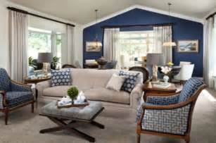 living room with blue accent wall pictures