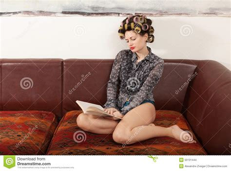 lying on the couch book portrait of a model with a book stock photo image 50131444