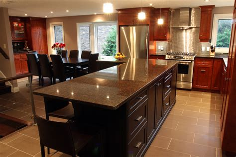 Kitchen Cabinets Wood Choices baltic brown granite makes your kitchen countertop looks