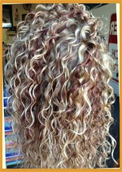 photos of the diffrence between a spiral perm and a nomal perm what type of perm is this clothes hair etc