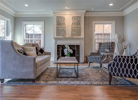 rugs to make room look bigger use area rug to make house look bigger decorating small spaces 10 mistakes that almost