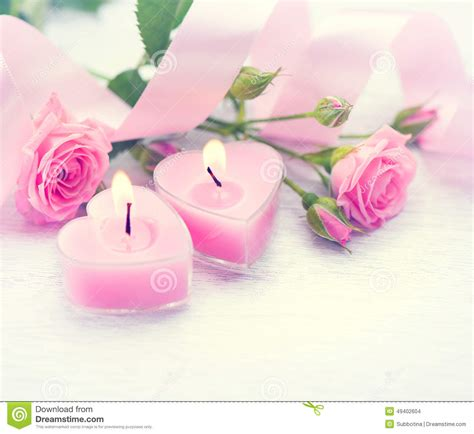 pink roses for valentines day s day pink shaped candles and roses stock