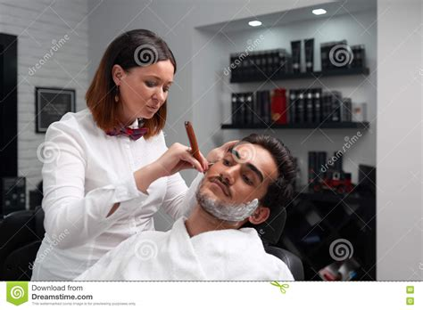 woman shave barber shop woman shave barber shop the barber woman carefully shaves