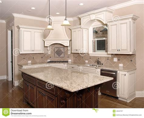 granite topped kitchen island luxury kitchen with granite island and window stock image
