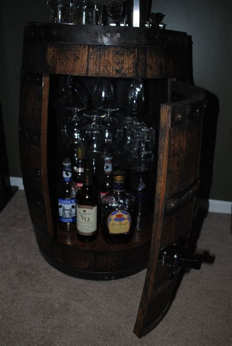 Whiskey Barrel Cabinet whiskey barrel liquor cabinet with lazy susan bottom