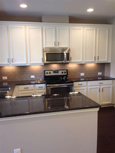 My new kitchen! White cabinets, tan subway tile backsplash