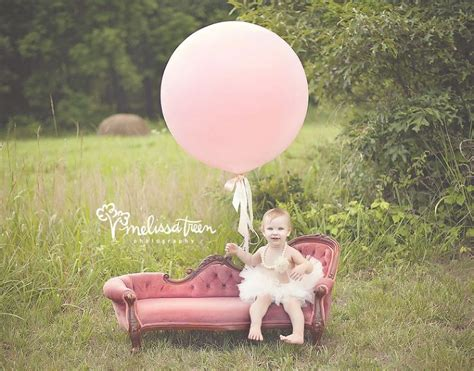 pink couch sessions one year baby girl on pink velvet couch sofa settee with