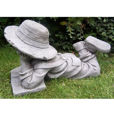 garden statue of boy and girl reading pair onefold uk