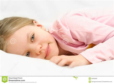 lay on the bed young little girl is laying on bed with peaceful f stock photo image 29480930