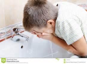 Boy washing face stock image image 17351451